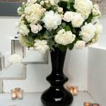 sculpted vase white flower arrangement candles