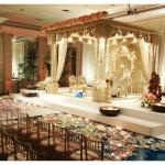 asian wedding stage flowers candles