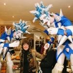 blue and white spiky stilt walkers