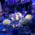 purple and white flowers table