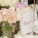close up name cards vase flowers
