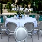 silver chairs white tables pool