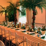 London Party Planner palm tree tables tropical